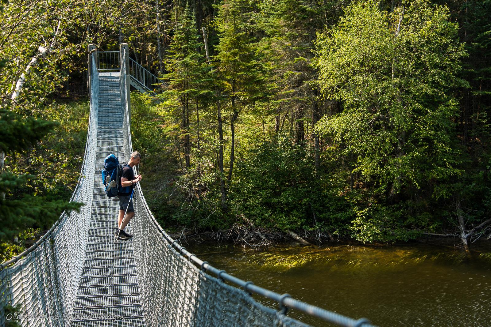 crossing suspension bridge over Willow River in Pukaskwa