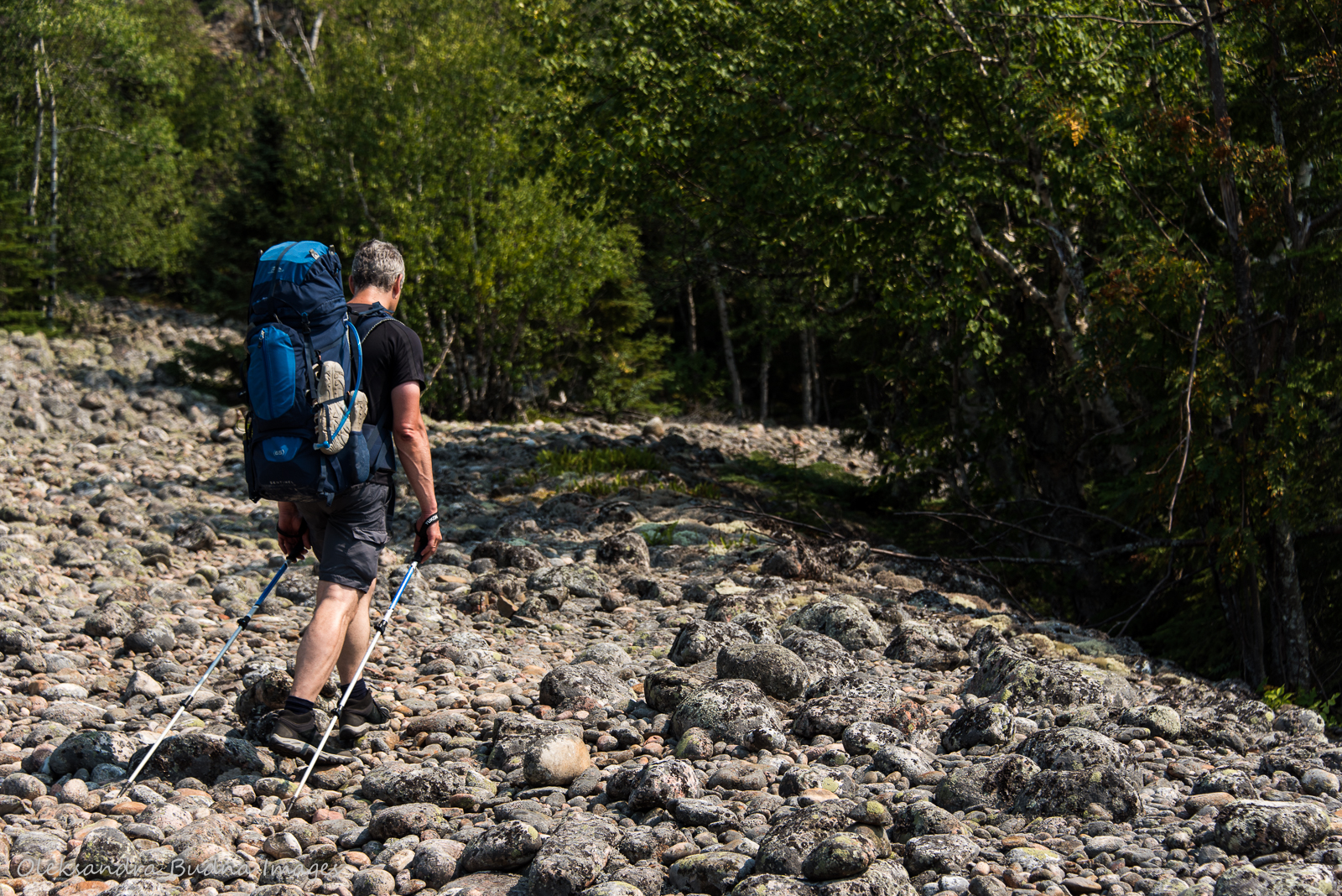 crossing a cobblestone field while backpacking in Pukaskwa