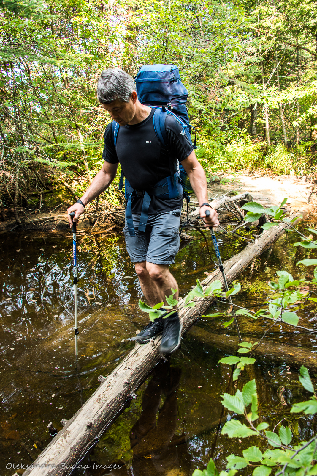 crossing a stream while backpacking in Pukaskwa