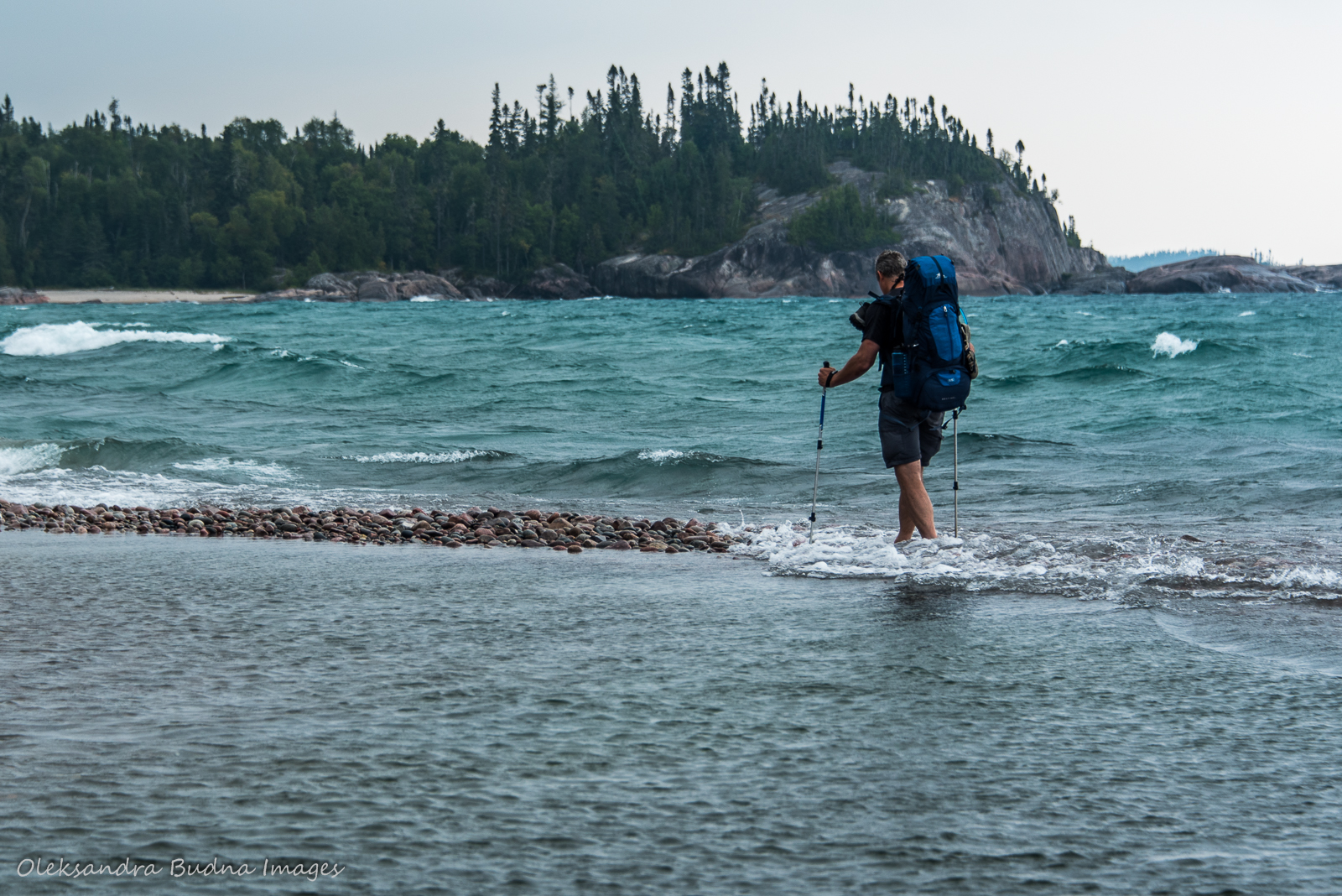 crossing White Gravel River while backpacking in Pukaskwa